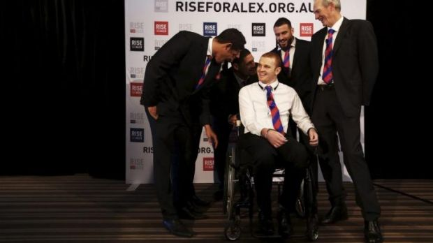 Support group: Alex McKinnon is flanked by Knights teammates Dane Gagai, Korbin Sims,  Willie Mason  and Darius Boyd, ...