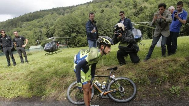 Down and out: Spain's Alberto Contador holds his knee after crashing on the 10th stage.
