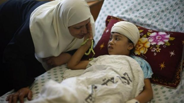 Nine-year-old Palestinian girl Maryam Al-Masri, who hospital officials said was wounded in an Israeli air strike, ...