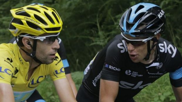 The leader chats to the challenger ... Italy's Vincenzo Nibali, wearing the overall leader's yellow jersey, and ...