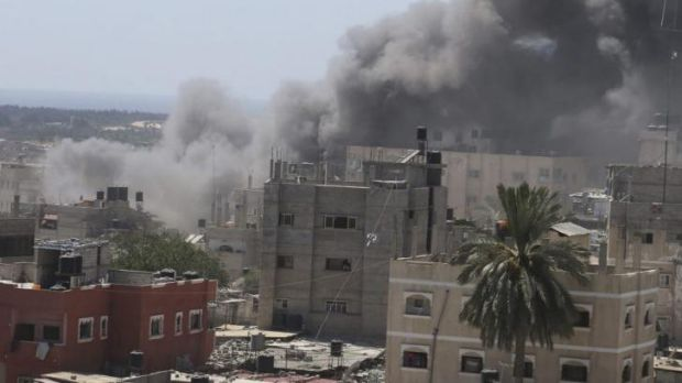 Smoke rises following what witnesses said was an Israeli air strike on a house in Rafah in the southern Gaza Strip.
