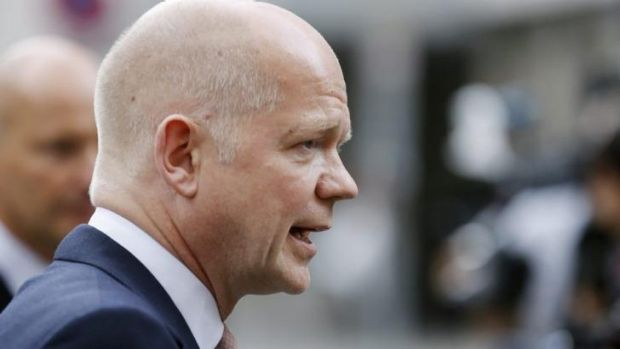British Foreign Secretary William Hague talks to the media outside diplomatic talks in Vienna in July.