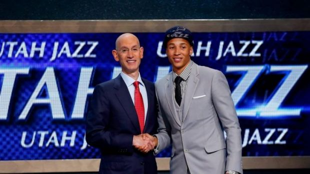 NBA commissioner Adam Silver and Dante Exum.