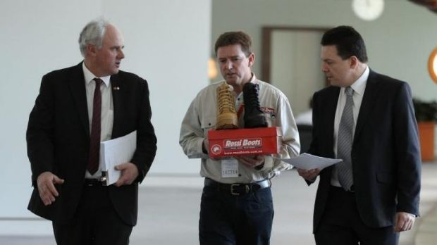 DLP Senator John Madigan (left) and Independent Senator Nick Xenophon (right) together with Rossi Boots CEO Neville ...