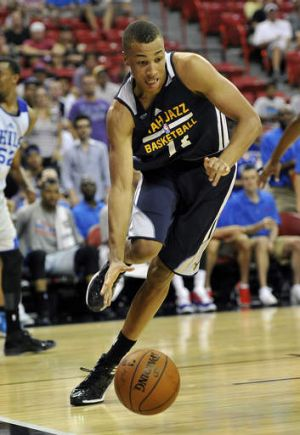Starting out: Utah Jazz's Dante Exum drives to the hoop against the Philidelphia 76ers during an NBA summer league game ...