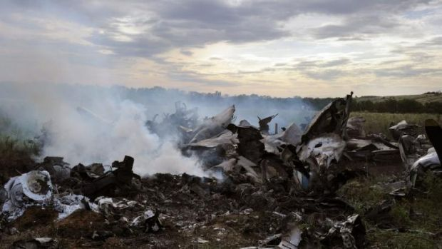 The wreckage of a Ukrainian AN-26 military transport plane after it was shot down by a missile in the village of ...