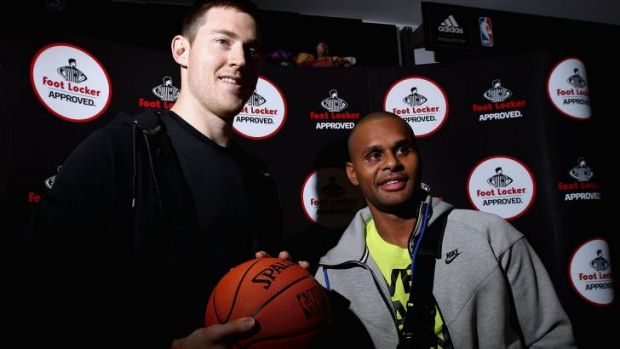 Back home: Patty Mills (right) and Aron Baynes  on Tuesday.