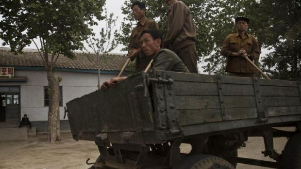 North Korean men ride in a farmer's wagon in North Korea's South Hamgyong province. North Korea has struggled to obtain ...