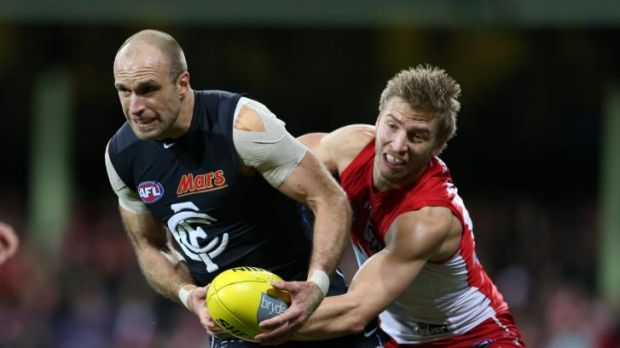 Chris Judd tries to escape the clutches of Sydney's Kieren Jack in round 17.