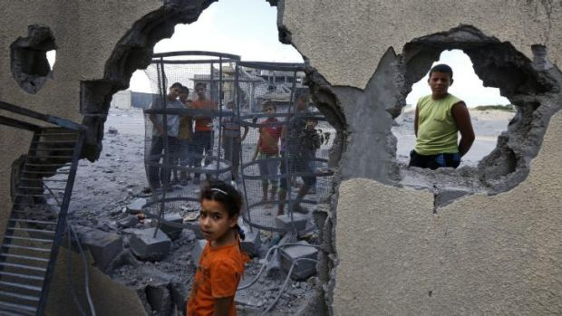 Palestinian children near the site of an Israeli missile strike in Rafah, southern Gaza Strip.