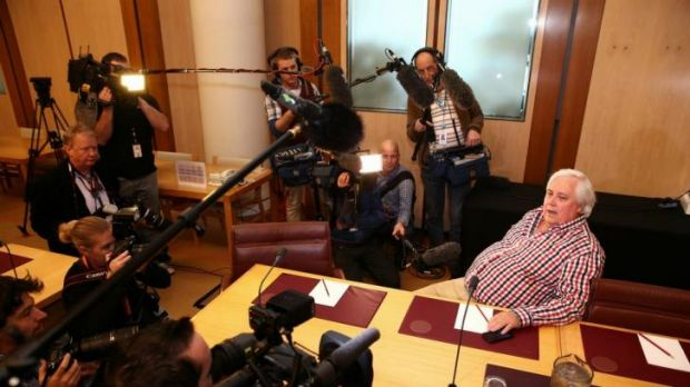 Holding court: Clive Palmer addresses the media.