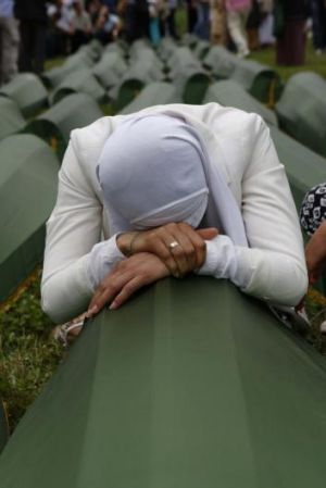 Genocide: A Bosnian Muslim woman cries on a coffin in Srebrenica last Friday as thousands of people gathered for the ...