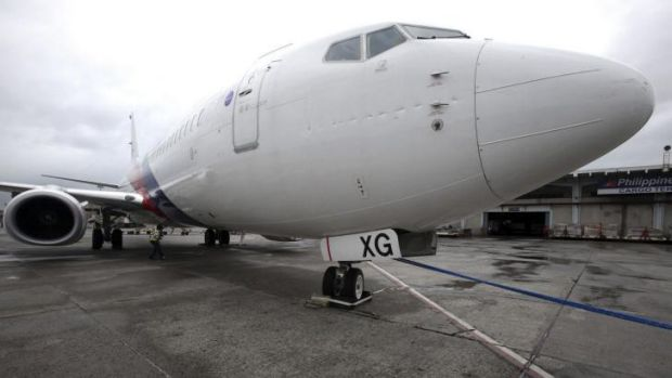 A Malaysian Airlines passenger plane was slightly damaged after it was swept 50 metres away while parked at Ninoy Aquino ...