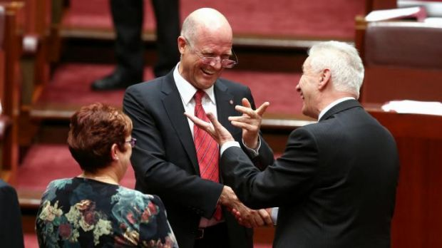 Senator David Leyonhjelm is congratulated by Senator Doug Cameron after delivering his first speech in the Senate last week.