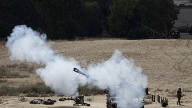 An Israeli mobile artillery unit fires towards Gaza.