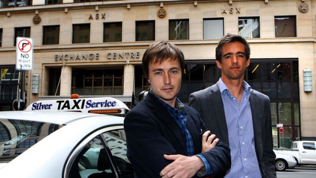 Andrew Campbell and Ned Moorfield of goCatch with a cab outside their office in Sydney.