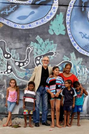 Pen power: Cuban ambassador Pedro Monzon and Cuban teacher Lucy Nunez with Aboriginal children in Bourke.