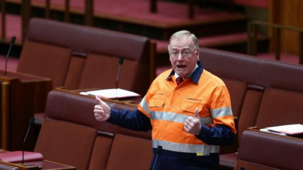 """Disorderly"": Liberal Senator Ian Macdonald donned a high-vis ""Australians for Coal"" provided by the Minerals Council ..."