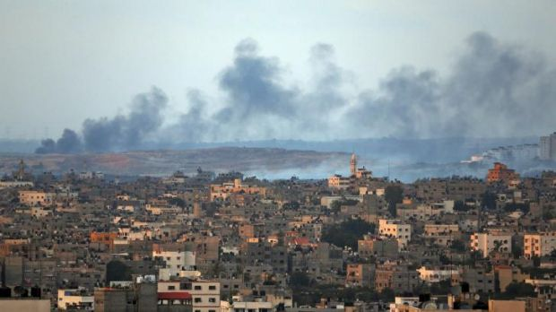 Smoke rises after an Israeli missile strike hit the northern Gaza Strip on Thursday. Ground forces are now on the way.