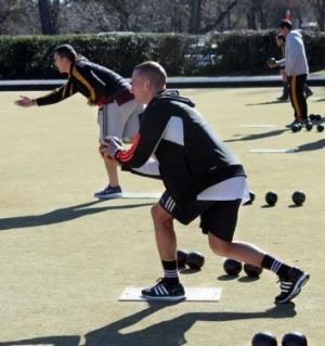 Waikato Chiefs flyhalf Aaron Cruden enjoys a game of lawn bowls at the ACT Rugby Union Club on Friday in the build-up to ...
