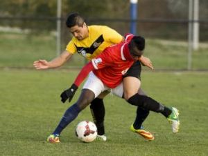 Canberra FC's Alex Oloriegbe and Cooma's Jordano Sanmartin.