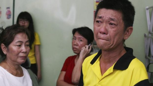 A relative of an Indonesian aboard MH17 cries in North Sumatra.