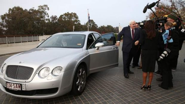 Space hog: Clive Palmer alights from his Bentley.