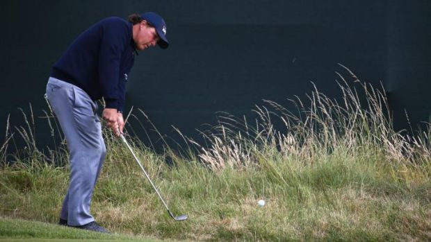 Phil Mickelson hits a pitch shot on the third hole during the second round of the British Open on Friday.
