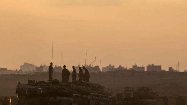 Tank-top watch: Israeli forces operating the length of the Gaza Strip have advanced up to three kilometres into the ...