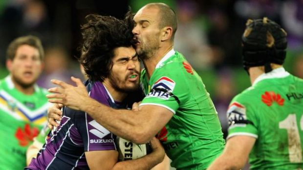 Head clash: Melbourne forward Tohu Harris and Raiders prop Dane Tilse meet in the middle.