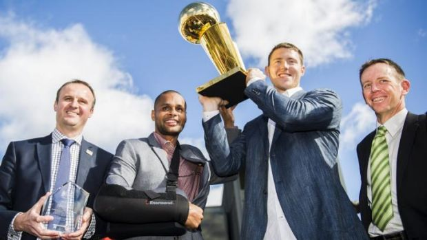 Andrew Barr, Patrick Mills, Aron Baynes, and Shane Rattenbury with the Keys to the City and NBA Trophy.