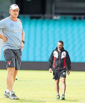 Different perspectives: While John Longmire's Sydney Swans are flying, for Alan Richardson's battling Saints, the only ...