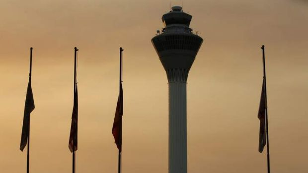 Flags hung at half-mast at the Kuala Lumpur International Airport in Sepang, as a sign of respect for those killed in ...