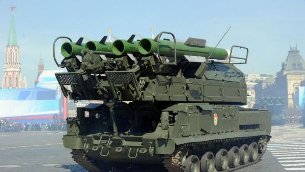 This file picture taken on May 9, 2013 shows a Russia's air defence system Buk-2M arnoured launcher vehicles at the Red ...