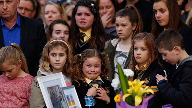 Grief: Children at Sunday's service.