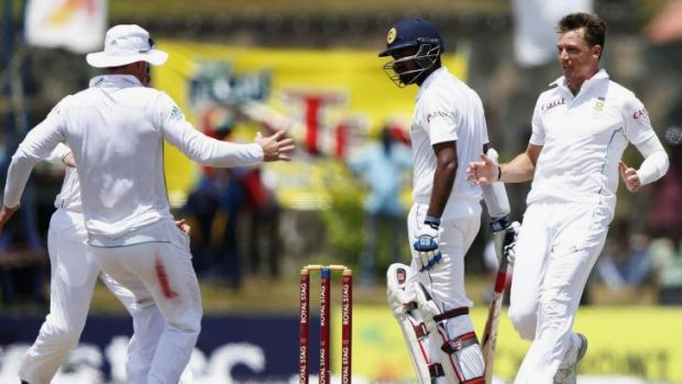 Dale Steyn (right) rushes to celebrate with A.B. de Villers (left) after having Lahiru Thirimanne caught in the slips.