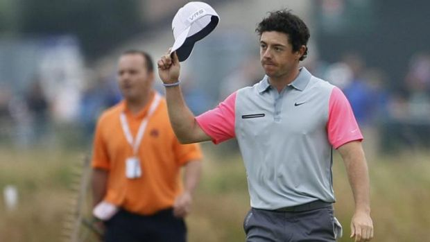 Rory McIlroy acknowledges the crowd as he walks up to the 18th green to claim the British Open at Hoylake.