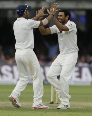 India's Mohammed Shami, right, celebrates with Ajinkya Rahane the wicket of England's Gary Ballance.