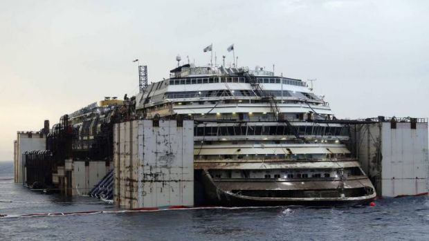 Technicians began a complex operation to refloat and tow away the wreck of the Costa Concordia, two and a half years ...