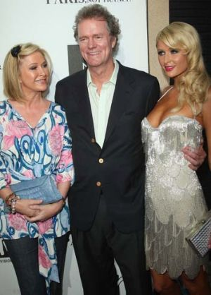 "Paris Hilton with her parents Rick and  Kathy Hilton at a screening of the documentary ""Paris, Not France"" in 2009."