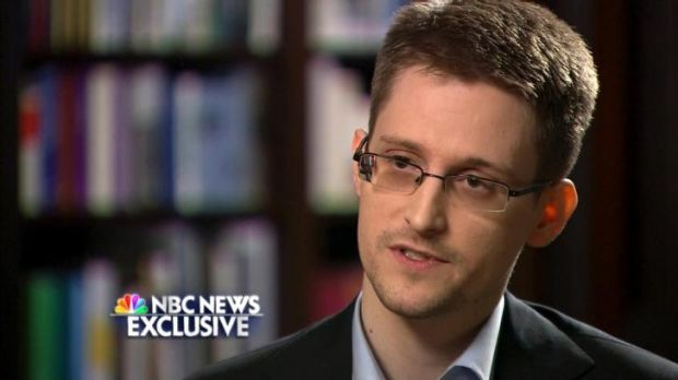 "Racy photos seen as a ""fringe benefit"" of surveillance positions, says Edward Snowden."