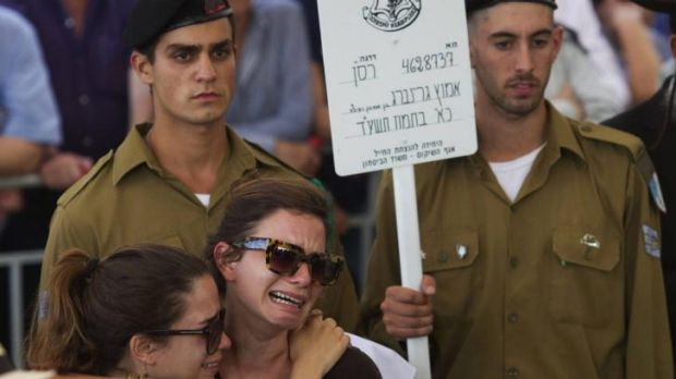 Israelis mourn at the funeral of soldier Amotz Greenberg in the central Israeli town of Hod HaSharon.