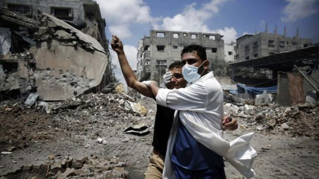 A medic helps a Palestinian in the Shujaiya neighbourhood of Gaza City, heavily shelled during the latest Israeli offensive.