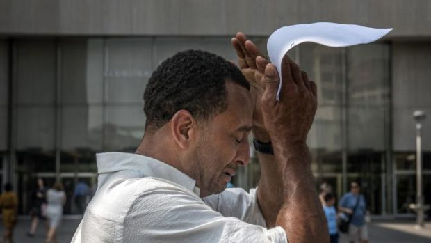 Kevin Martin becomes emotional as he leaves the Washington DC courthouse on Monday after being exonerated for a crime he ...