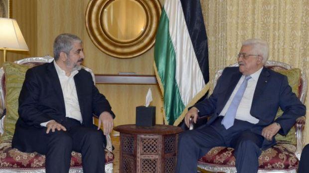 Palestinian President Mahmoud Abbas (right) meets Hamas leader Khaled Meshal in Doha, Qatar.