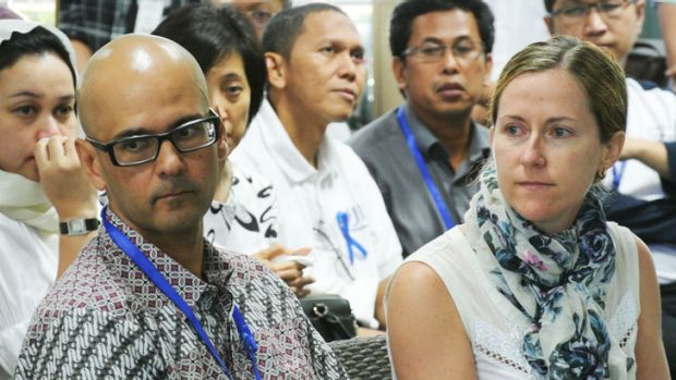 Neil Bantleman (front), with  wife Tracy, at the Jakarta International School on the day he was taken into police custody.