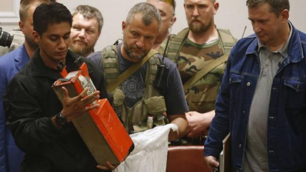 A Malaysian expert examines the MH17 black box after receiving it from pro-Russian rebels.