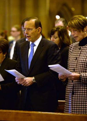 Abbott talks tough: Prime Minister Tony Abbott with wife Margaret at a memorial service for victims of the MH17 crash.