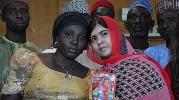 Pakistani activist Malala Yousafzai holds a picture of kidnapped schoolgirl Sarah Samuel with her mother Rebecca Samuel, ...