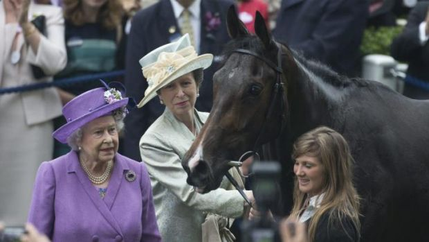 Britain's Queen Elizabeth II, with her daughter Princess Anne and her horse Estimate, who won the 2013 Ascot Gold Cup.